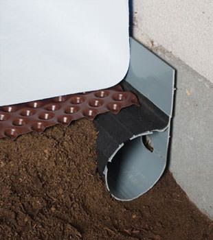 Closeup of a crawl space drainage system installed in Cassopolis