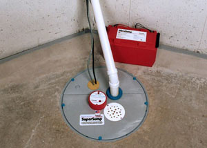 A sump pump system with a battery backup system installed in Middlebury