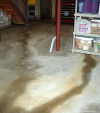 Flooding entering a basement through a floor crack in Knox