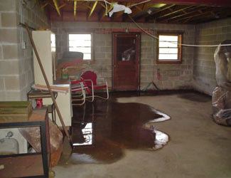 a flooded basement floor in a Walkerton home