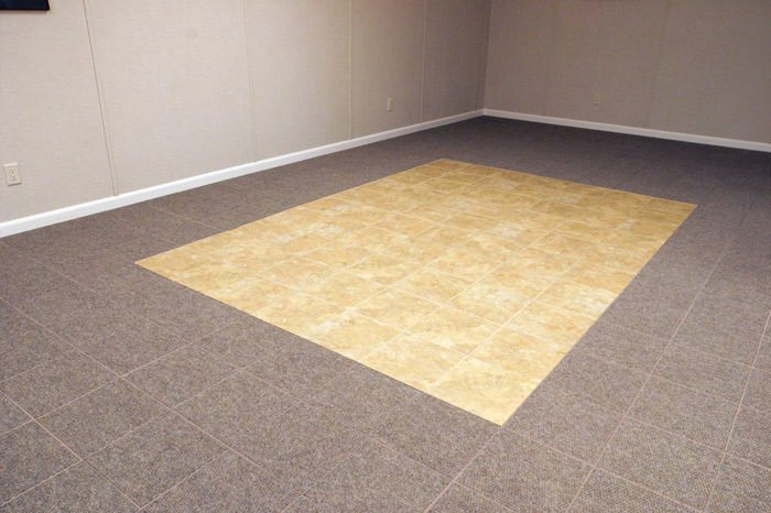tiled and carpeted basement flooring installed in a Goshen home