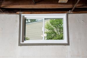Repaired waterproofed basement window leak in Goshen
